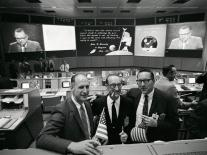 c3 - NASA officials and engineers celebrate the Apollo 11 landing as the CBS telecast featuring Walter Cronkite is broadcast on television screens in Mission Control.