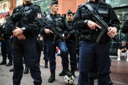 French gendarm keeps the ball of Wales' supporter as his unit patrols through the streets of Toulouse, southern France, on June 20, 2016 before the EURO 2016 match of Russia vs Wales. (AFP/KILIC)