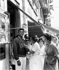 Cassius Clay on Via Veneto central strreet of Rome, showing the gold medal he won at the 1960 Rome Olympics, (Associated Press)