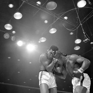 Clay and Liston in the sixth round of their Miami Beach fight in February 25, 1964 (Associated Press)