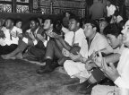 American boxer Muhammad Ali (4th from Right) prays with his hands open in a crowd at the Hussein Mosque in Cairo, 1964, Egypt (GettyImages/Express)