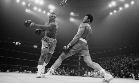 Muhammad Ali steps away from a punch thrown by boxer Joe Frazier during their heavyweight title fight at Madison Square Garden in 1971. (Bettmann/CORBIS)