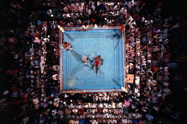 Aerial view of Foreman on canvas during count by referee Zach Clayton after round 8 knockout by Ali at Stade du 20 Mai, in Kinshasa, Zaire October 30, 1974 (Neil Leifer /Sports Illustrated)