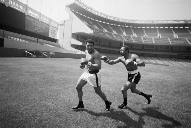 Boxer Ken Norton playfully chases champion Muhammad Ali across the field at Yankee Stadium. Norton lost the title fight to Ali at the stadium on September 28, 1976. (Marty Lederhandler/AP Photo)