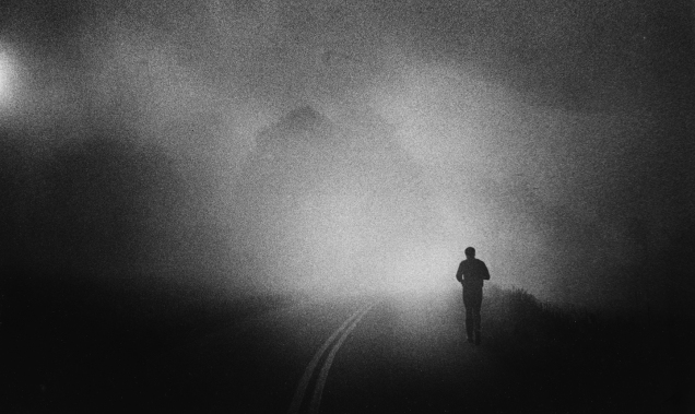 Muhammad Ali takes his daily three-mile run along a Pennsylvania country road shrouded in early morning fog near his Deer Lake training camp in 1978. (Keith Williams/TheCourier Journal) RIGHT: Time Magazine: June 20, 2016 Edition commemorative issue